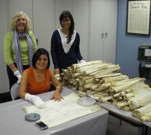 Nancy Atkins Peck, Xiomara Paredes and Faulizbeth Vallejo cleaning and examining the plans of architect Carl Kemm Loven at the headquarters of the Glen Rock Historical Society (left to right).