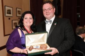 2009 President Stacey Ruhle Kliesch presents gavel to 2010 President Jason Kliwinski