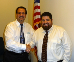 (Left to right) NJ State Board of Architects President, Michael G. Soriano, AIA congratulates Marco T. Migliaro, AIA at the State Board Meeting held on January 10, 2013 in Newark, NJ.