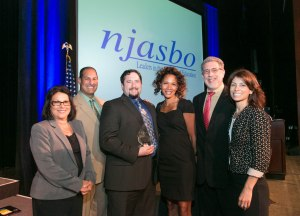 The NJASBO Associate Business Members Executive Committee congratulate Steven G. Siegel of Spiezle Architectural Group (center) as he accepts the association's Above & Beyond Award.  From left are President Nancy Riccio, G.R. Murray/O'Gorman & Young, Inc.; Secretary Alan Walker, Atlantic Tomorrows Office; Latonya Jackson, G.R. Murray/O'Gorman & Young, Inc.; Immediate Past President Bill Pappalardo, GREYHAWK Construction Managers & Consultants; and Vice President Christine Messina, All Risk, Inc.